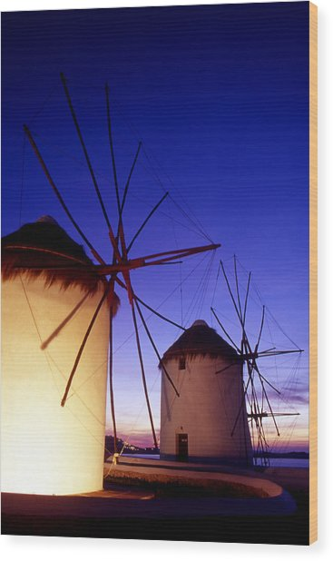 Greece. Mykonos Town. Illuminated Windmills At Dusk. Wood Print by Steve Outram