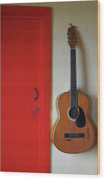 Guitar And Red Door Wood Print