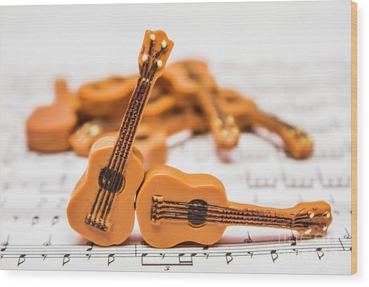Guitars On Musical Notes Sheet Wood Print