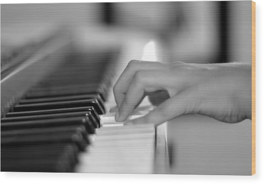 Hand On Piano Keyboard Wood Print