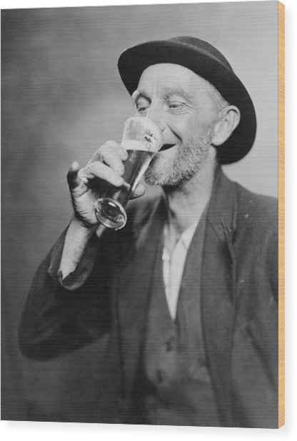 Happy Old Man Drinking Glass Of Beer Wood Print by Everett