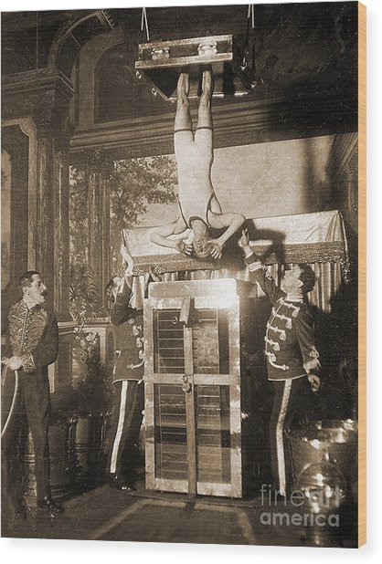 Harry Houdini Suspended Above A Tank Of Water  Wood Print