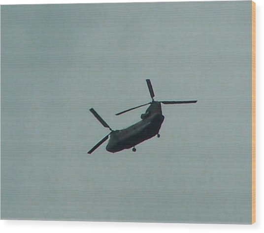 Helicopter Leaving Airport Wood Print by Lila Mattison