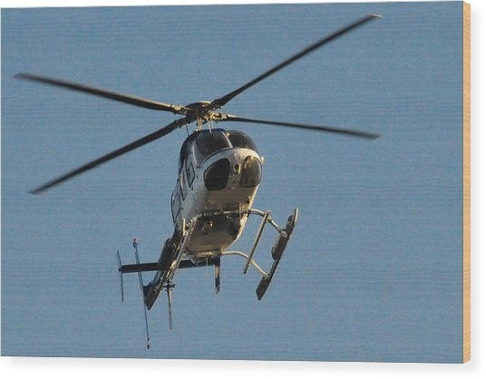 Helicopter On Final Approach  Wood Print by Bill Perry