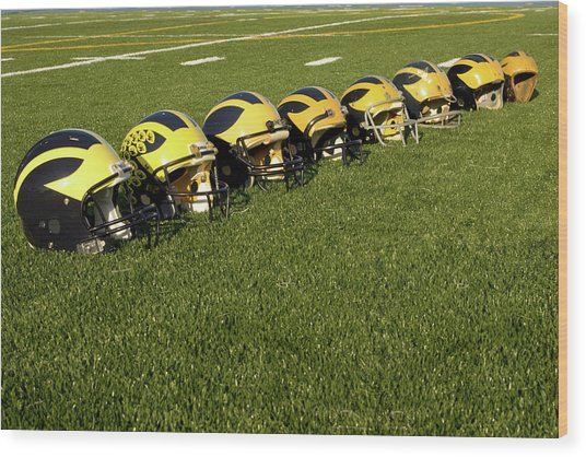 Helmets Of Different Eras On The Field Wood Print