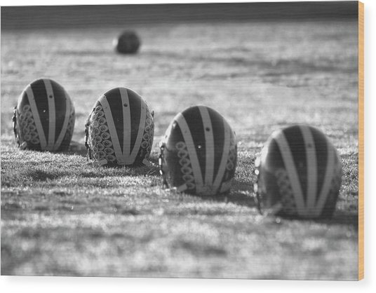 Helmets On Dew-covered Field At Dawn Black And White Wood Print