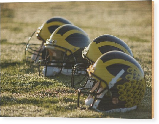 Helmets On The Field At Dawn Wood Print