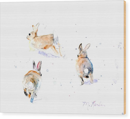 Hightailing Bunnies Wood Print