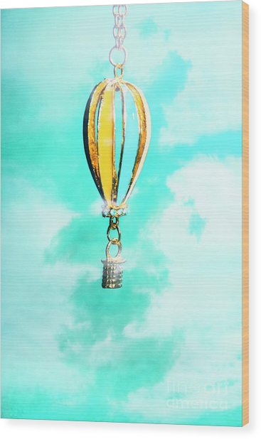 Hot Air Balloon Pendant Over Cloudy Background Wood Print