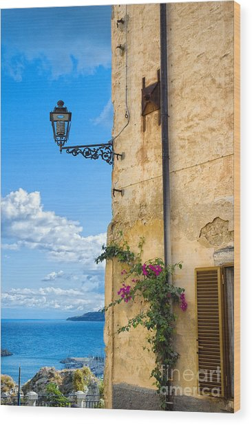 House With Bougainvillea Street Lamp And Distant Sea Wood Print