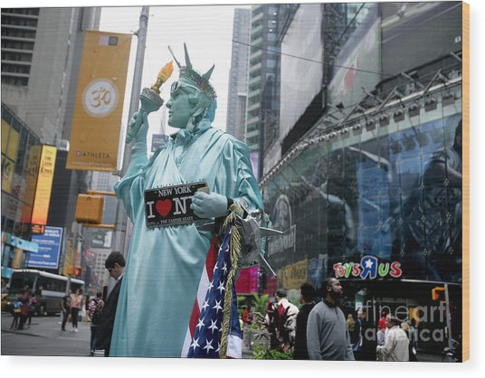 Human Statue Of Liberty In Times Square Wood Print by Bruce Crummy