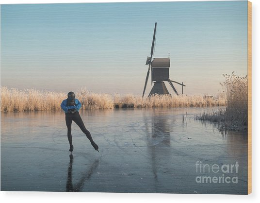 Ice Skating Past Frosted Reeds And A Windmill Wood Print
