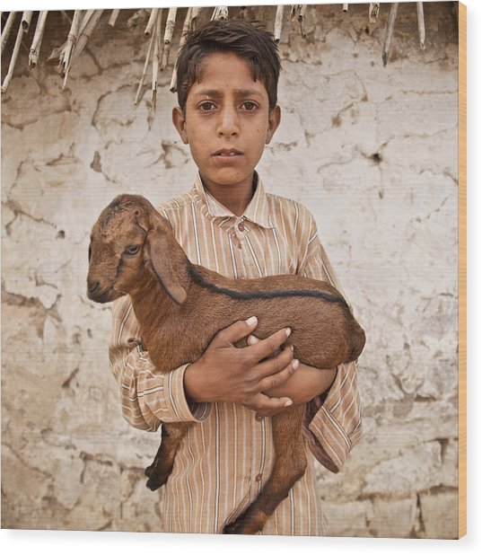 Kid With Goat Wood Print
