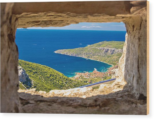 Komiza Bay Aerial View Through Stone Window Wood Print