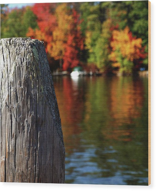 Lake Winnepesaukee Dock With Foliage In The Distance Wood Print