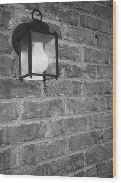 Lantern On Brick Wall  Wood Print by Nicole Aponte
