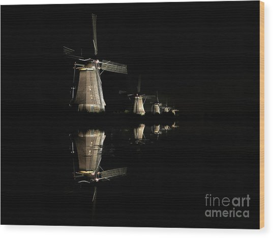 Lighted Windmills In The Black Night Wood Print