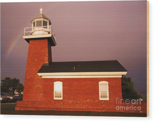 Lighthouse In A Rainbow Wood Print