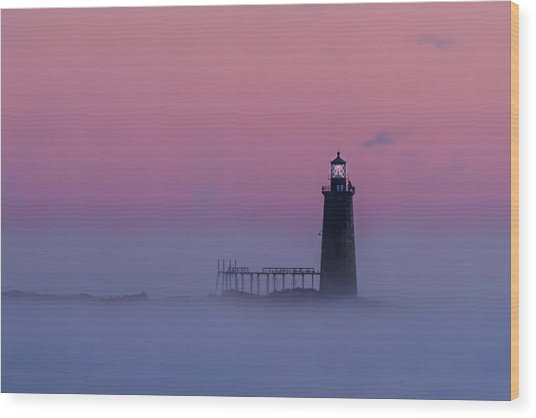 Lighthouse In The Clouds Wood Print