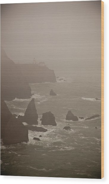 Lighthouse In The Fog Wood Print by Patrick  Flynn