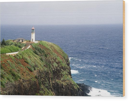Lighthouse On A Cliff Kileaua Lighthouse Wood Print by George Oze