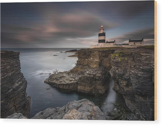 Lighthouse On Cliffs Wood Print