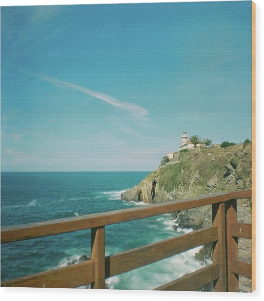 Lighthouse Over The Ocean Wood Print