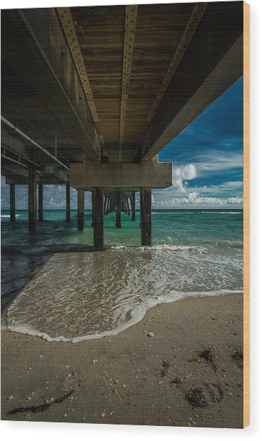 Looking Under The Pier Wood Print
