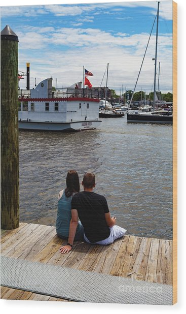 Man And Woman Sitting On Dock Wood Print