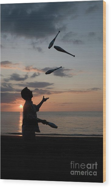 Man Juggling With Four Clubs At Sunset Wood Print