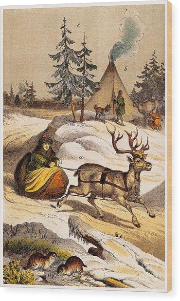 Man Riding Reindeer-drawn Sleigh Wood Print