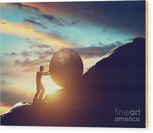 Man Rolling Huge Concrete Ball Up Hill Wood Print
