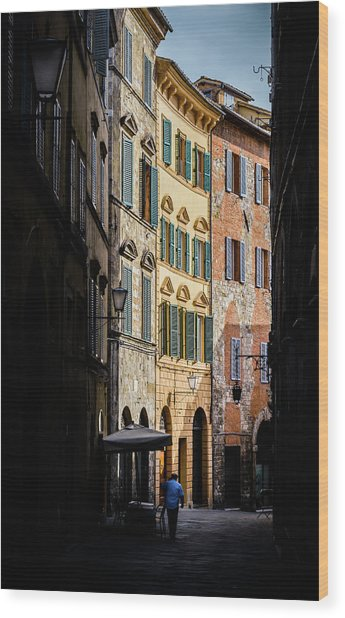 Man Walking Alone In Small Street In Siena, Tuscany, Italy Wood Print