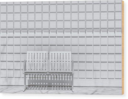 Metal Bench Against Concrete Squares Wood Print