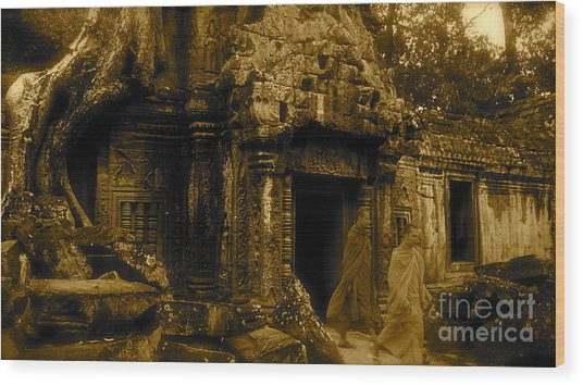 Monks Leaving Angkor Wat Wood Print by Louise Fahy