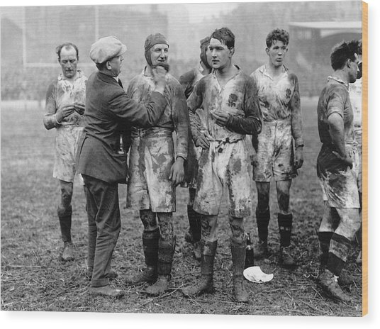 Muddy Players Wood Print by Hulton Collection