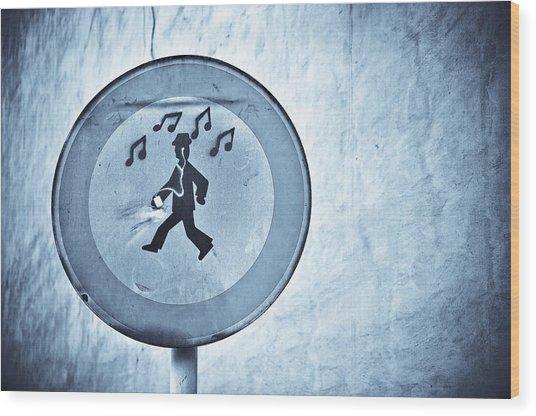 Musicman Walking Wood Print by Keith Sanders