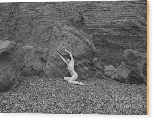 Nude Woman Pulling Shape By Rocks Wood Print