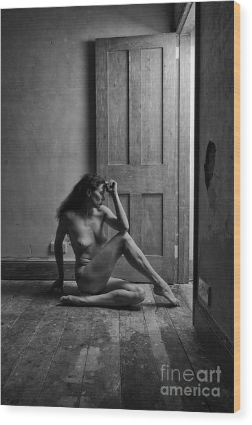 Nude Woman Sitting By Doorway In Abandoned Room Wood Print