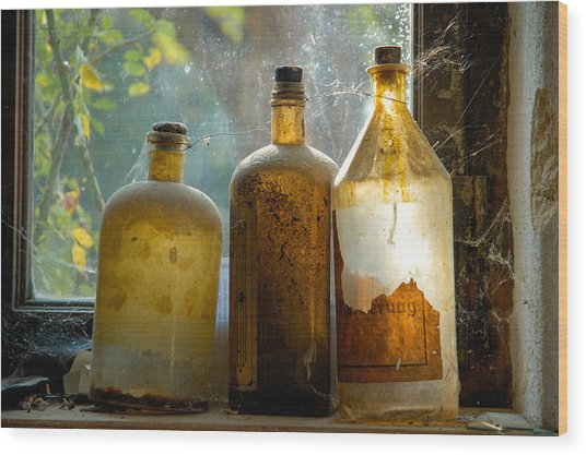 Old And Dusty Glass Bottles Wood Print
