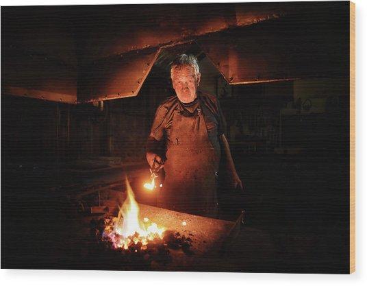 Old-fashioned Blacksmith Heating Iron Wood Print