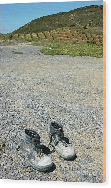 Old Pair Of Worn Out Boots Sitting On Stony Asphalt Wood Print by Sami Sarkis