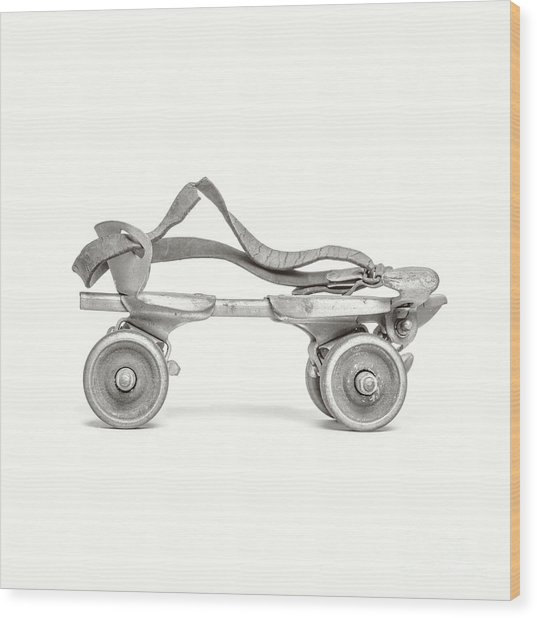 Wood Print featuring the photograph Old Rollerskate Black And White by Edward Fielding