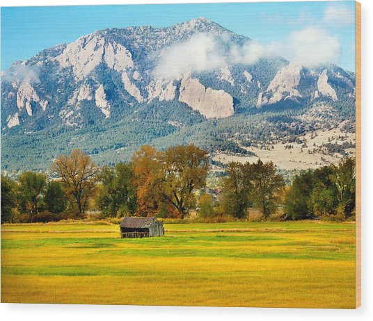 old shed against Flatirons Wood Print
