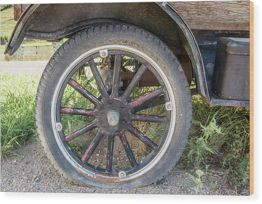 Old Truck Tire In Rural Rocky Mountain Town Wood Print