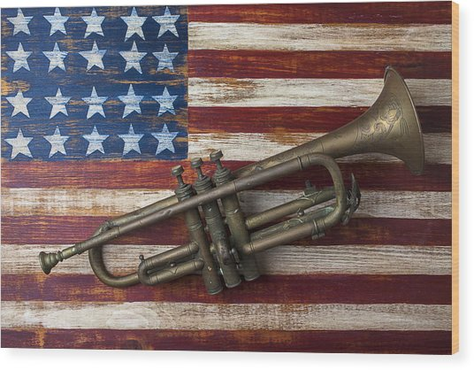 Old Trumpet On American Flag Wood Print