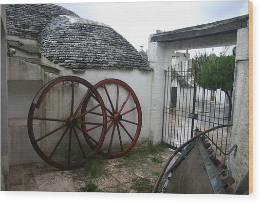 Old Wagon Wheels Wood Print by Dennis Curry
