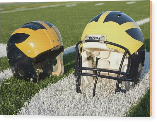 One Old, One New Wolverine Helmets On The Field Wood Print