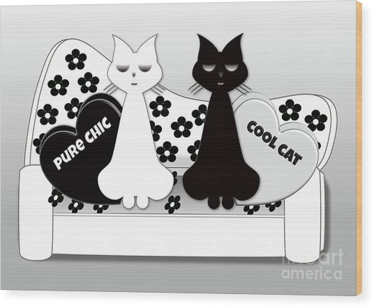 Opposites Attract - Black And White Cats On The Sofa Wood Print
