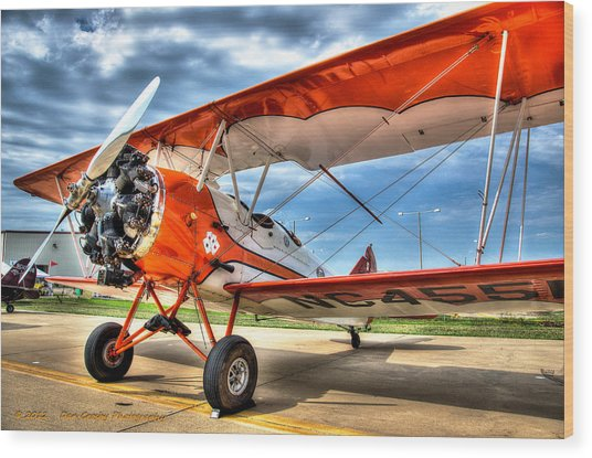 Orange Bi-plane Wood Print by Dan Crosby